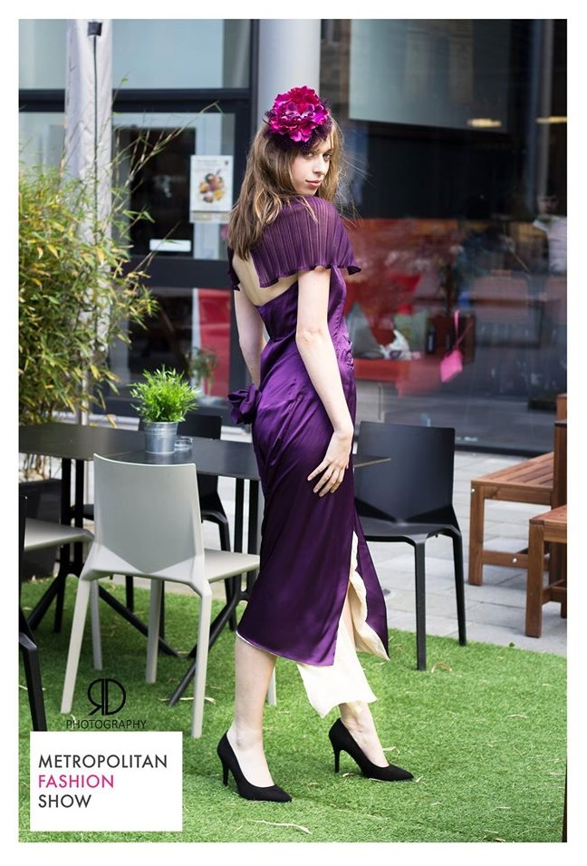 purple wrap dress with ceise feather cocktail hat