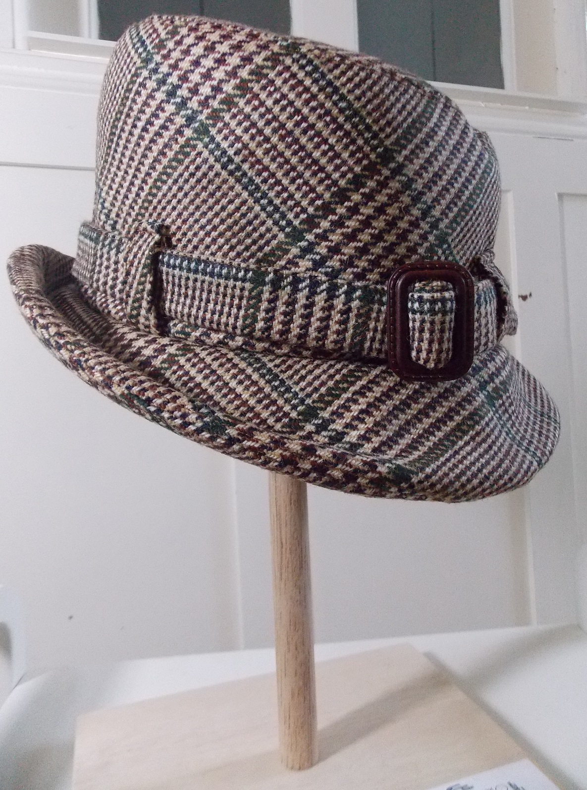 from the front with right brim up